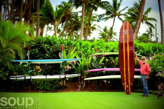 Larry Padilla stands next to his client's new Custom Surf Board Racks