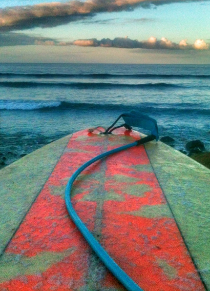 surfing maui guardrails surfboard red