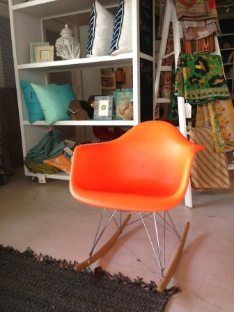 Have a seat in this modern orange rocker...
