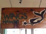 wings.hawaii.paia.news.sign.wood