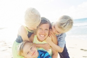 fun beautiful family photographs on beach in lahaina maui by pho